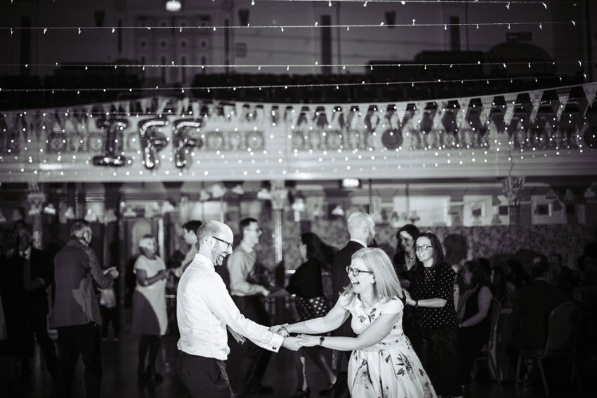 Wedding guests dance to the ceilidh band at Victoria Hall in Saltaire.