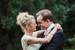 Natural Harrogate wedding photography Yorkshire UK. Bride and groom with pastel coloured flowers in hair and buttonhole.