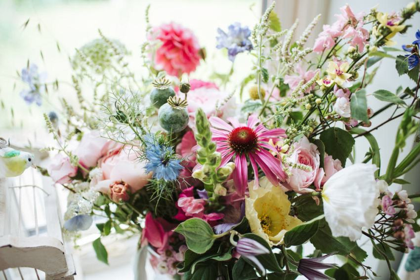 Brides wild flower bouquet in pink, yellow, blue and white.
