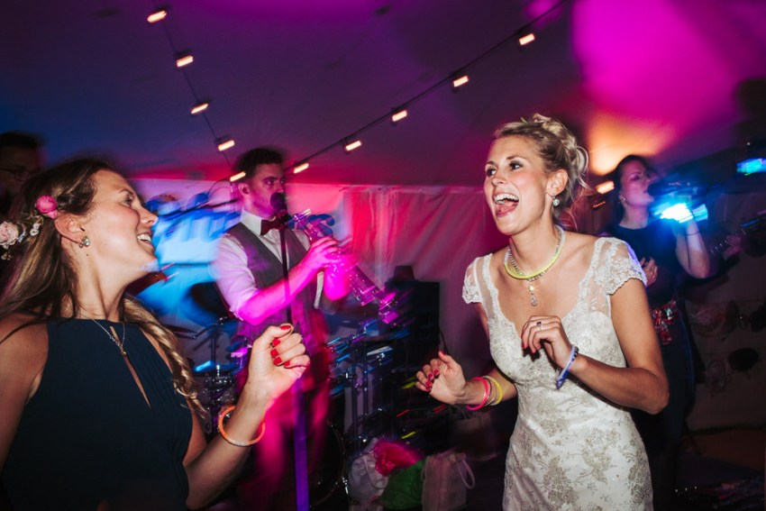 Bride dances with bridesmaid.