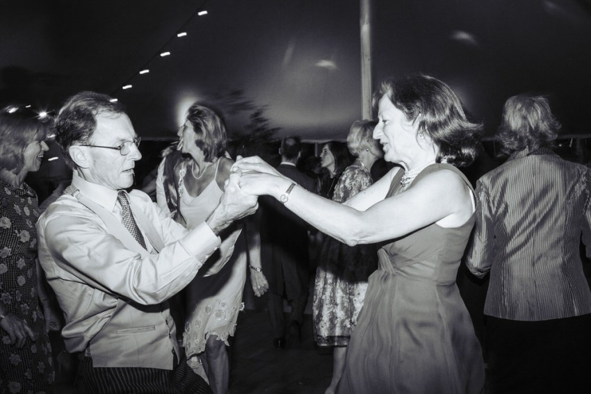Natural York wedding photography UK, guests dancing.