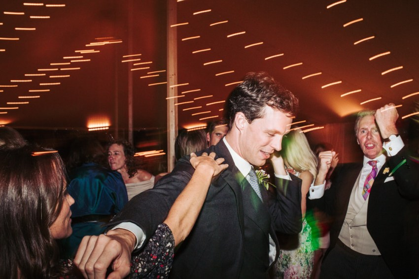 Candid moments of wedding guests on the dance floor. York wedding.