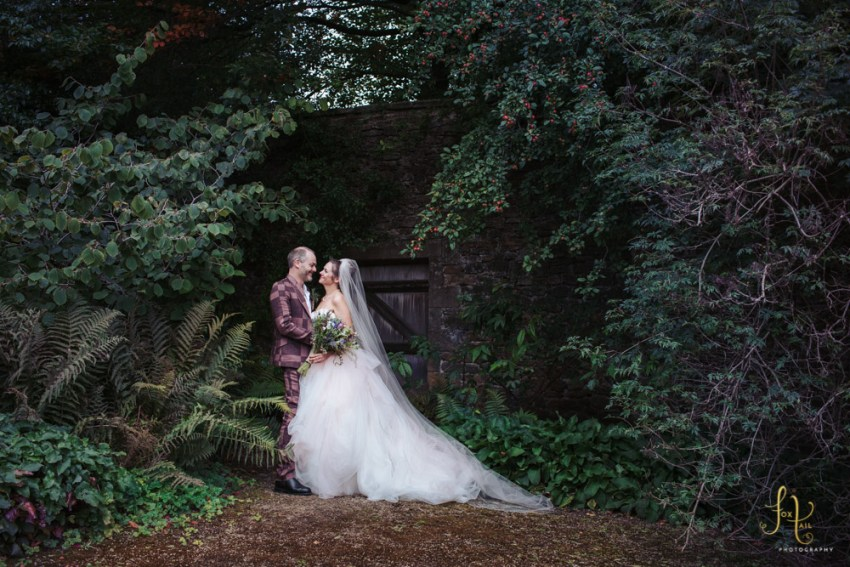 Broughton Hall wedding at Utopia. Skipton photographer, Yorkshire UK. Bride & groom embrace in the walled garden.