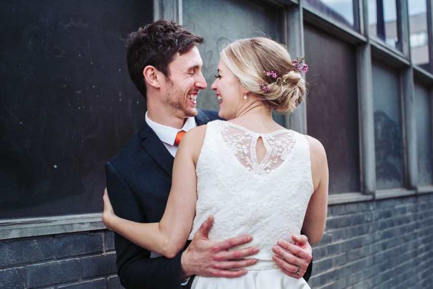 Trafalgar Warehouse wedding photography Sheffield Yorkshire. Bride and groom embrace and laugh.