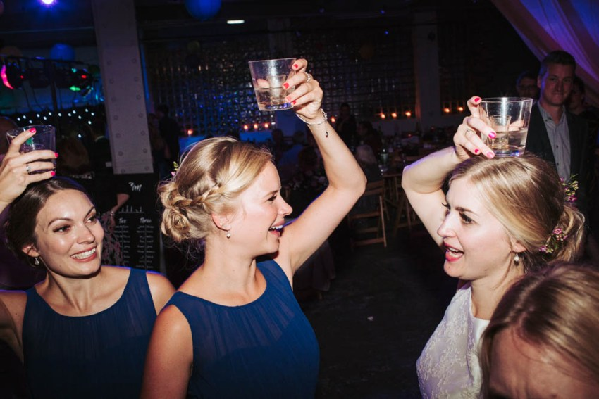 Bridesmaids and bride drinking shots.