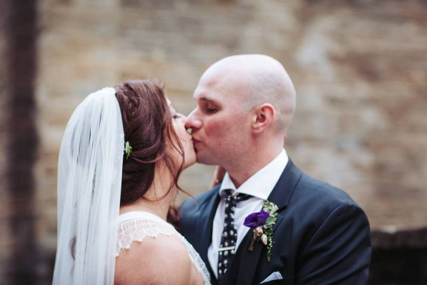 Bride and groom kiss.