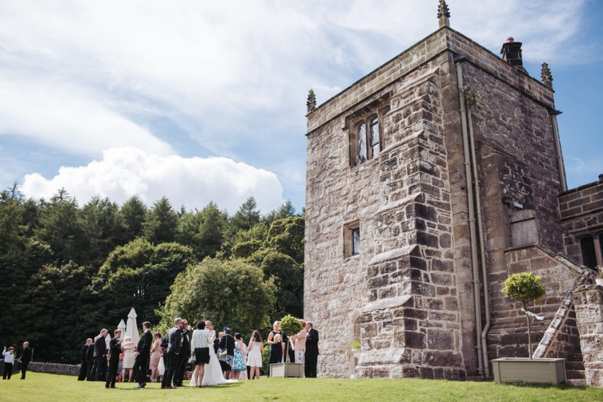 View of guests mingling outside the Priest House.