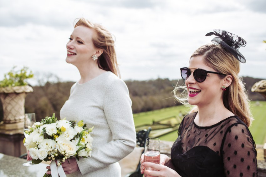 Bride and guest laughing.