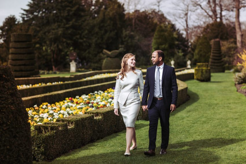 Cliveden House wedding photographer. Bride and groom walk the gardens prior to their ceremony.
