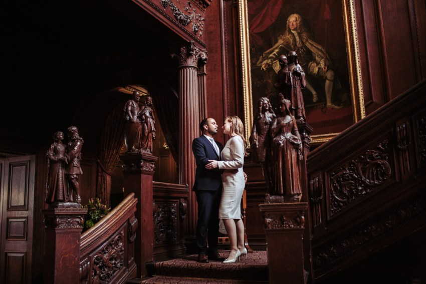Cliveden House wedding photographer Beerkshire. Bride and groom on the decorative wood staircase.