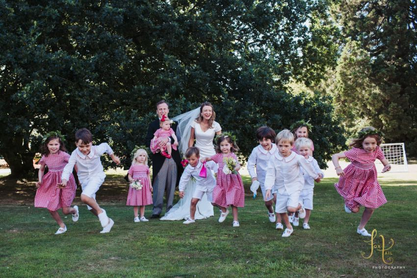 Page boys wear Amelia Brennan shirts, flower girls wear Pepa and Co. dresses. Children running.