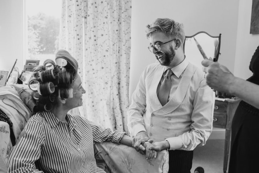 Touching moment between bride and her brother during bridal prep.