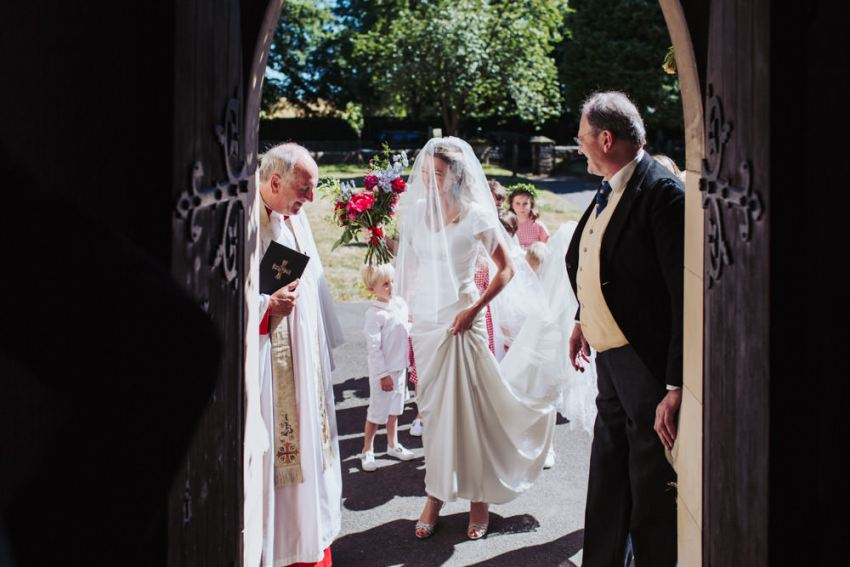 Harrogate church wedding, Staveley All Saints. Bride arrives at church door.