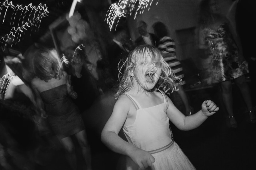 Young girl dancing and sining with hair flicked over her face.