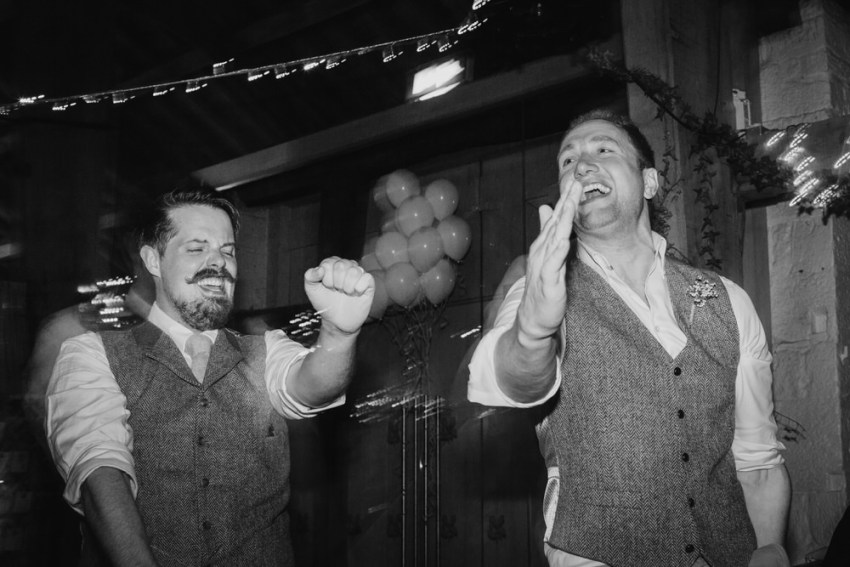 Groom and best man dancing at ERH.