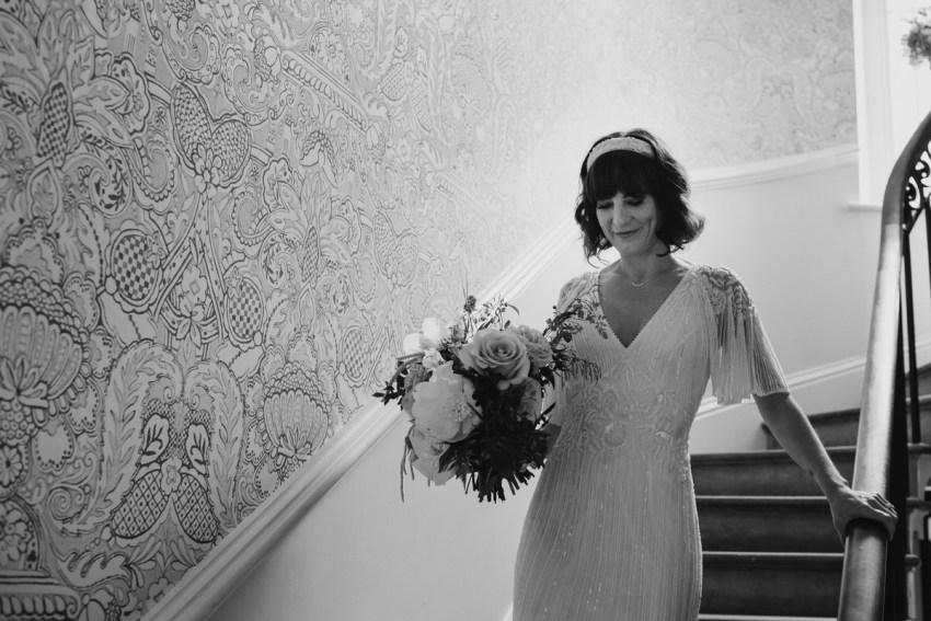 Bride walks down the stairs.