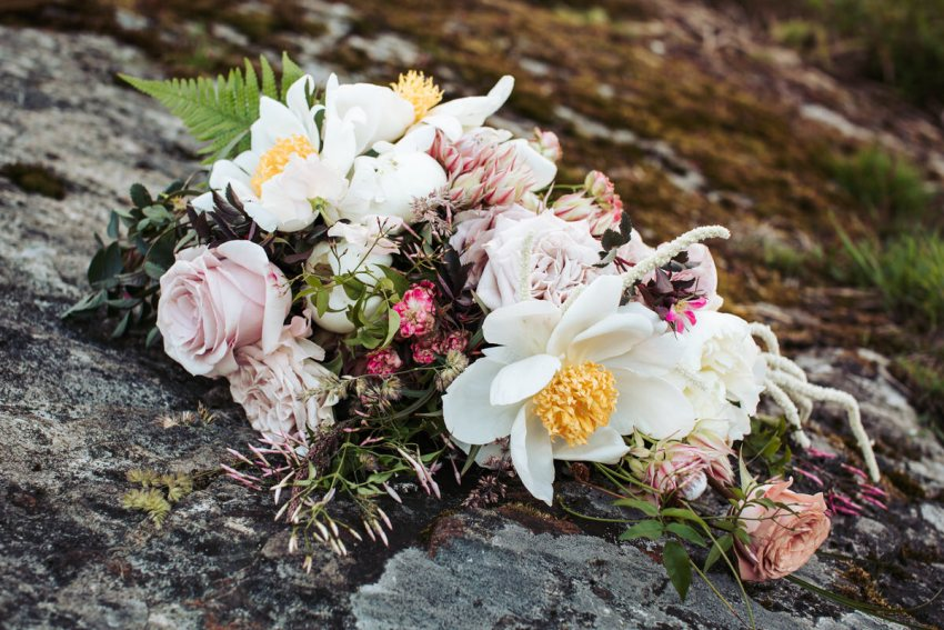 Romantic wedding bouquet with dusky pink and white flowers. White peonies and pink roses.