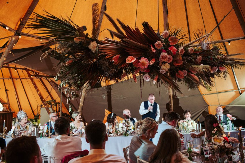 Best man makes his speech in the tipi.