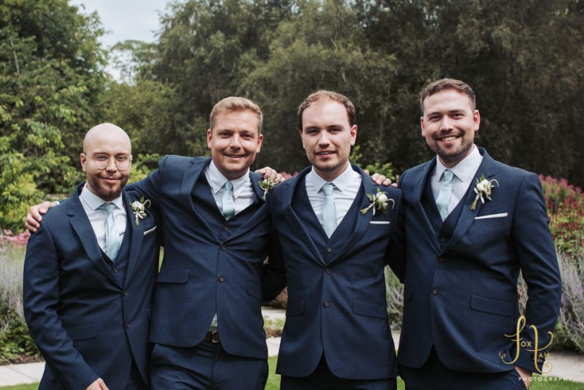 Portrait of groom with his three brothers.