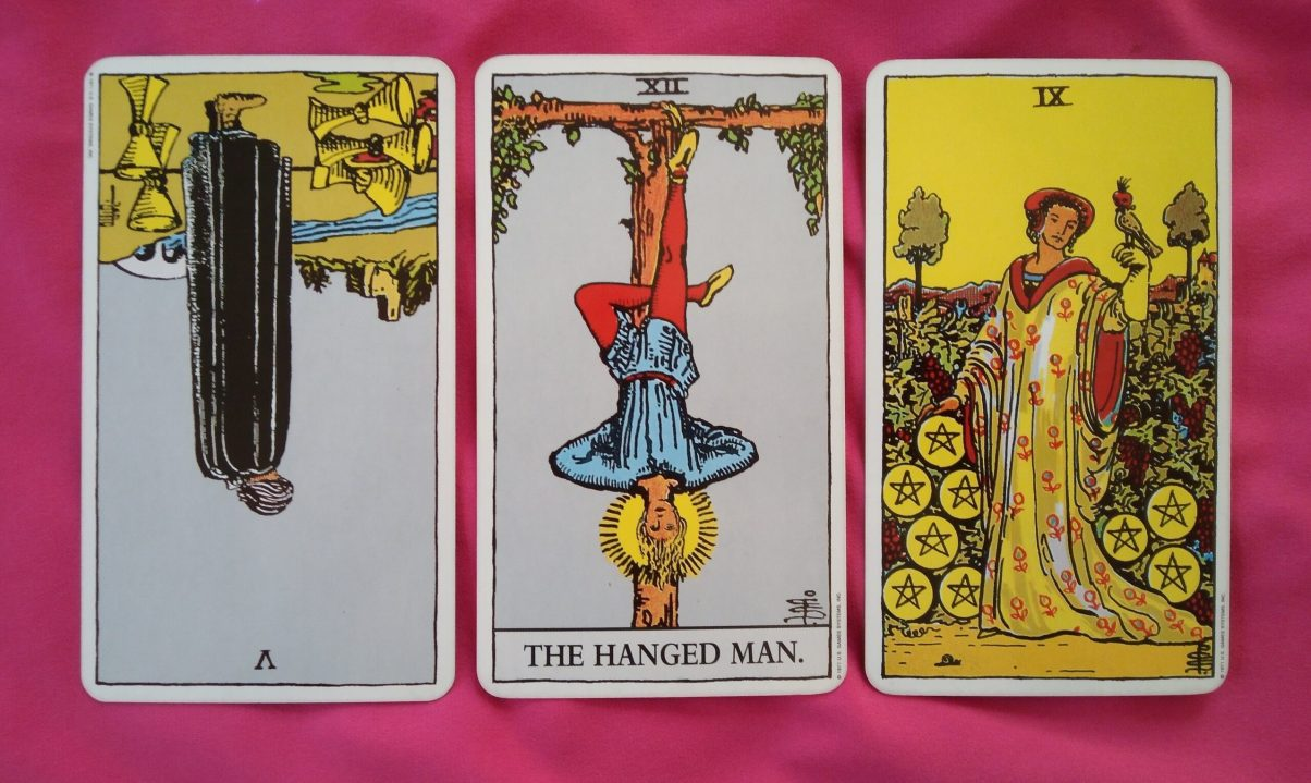 daily online tarot reading cards: 5 of Cups reversed, The Hanged Man, 9 of Pentacles