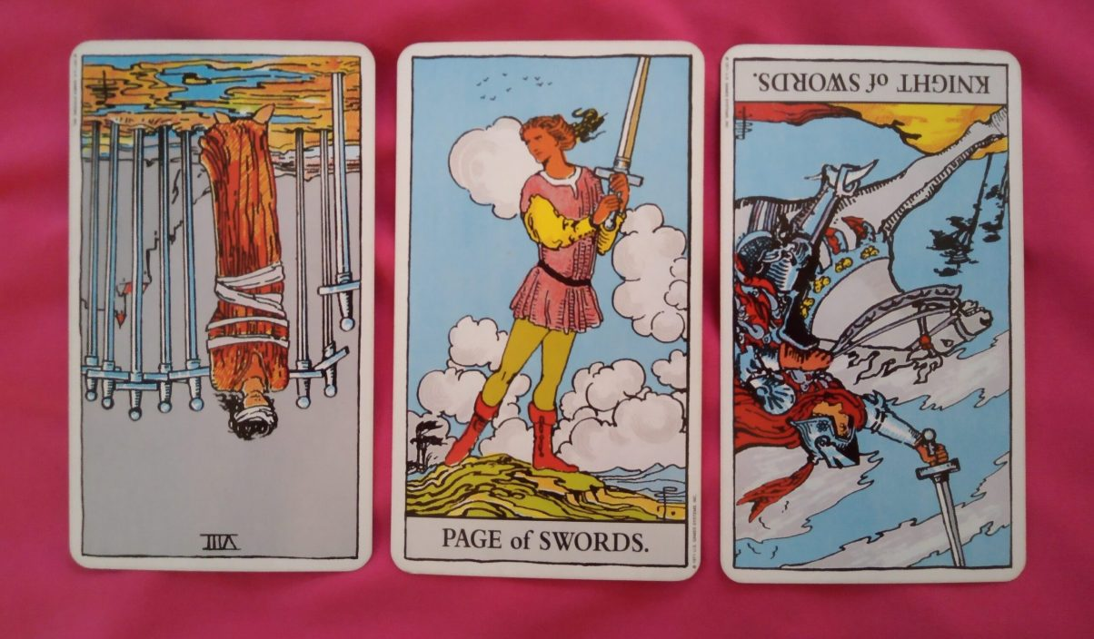daily online soul purpose tarot reading cards: 8 of Swords reversed, Page of Swords, Knight of Swords reversed
