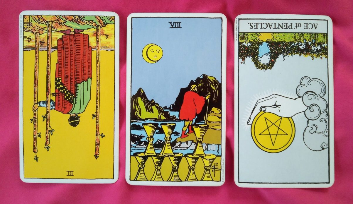 weekly online soul purpose tarot reading cards: 3 of Wands reversed, 8 of Cups and Ace of Pentacles reversed