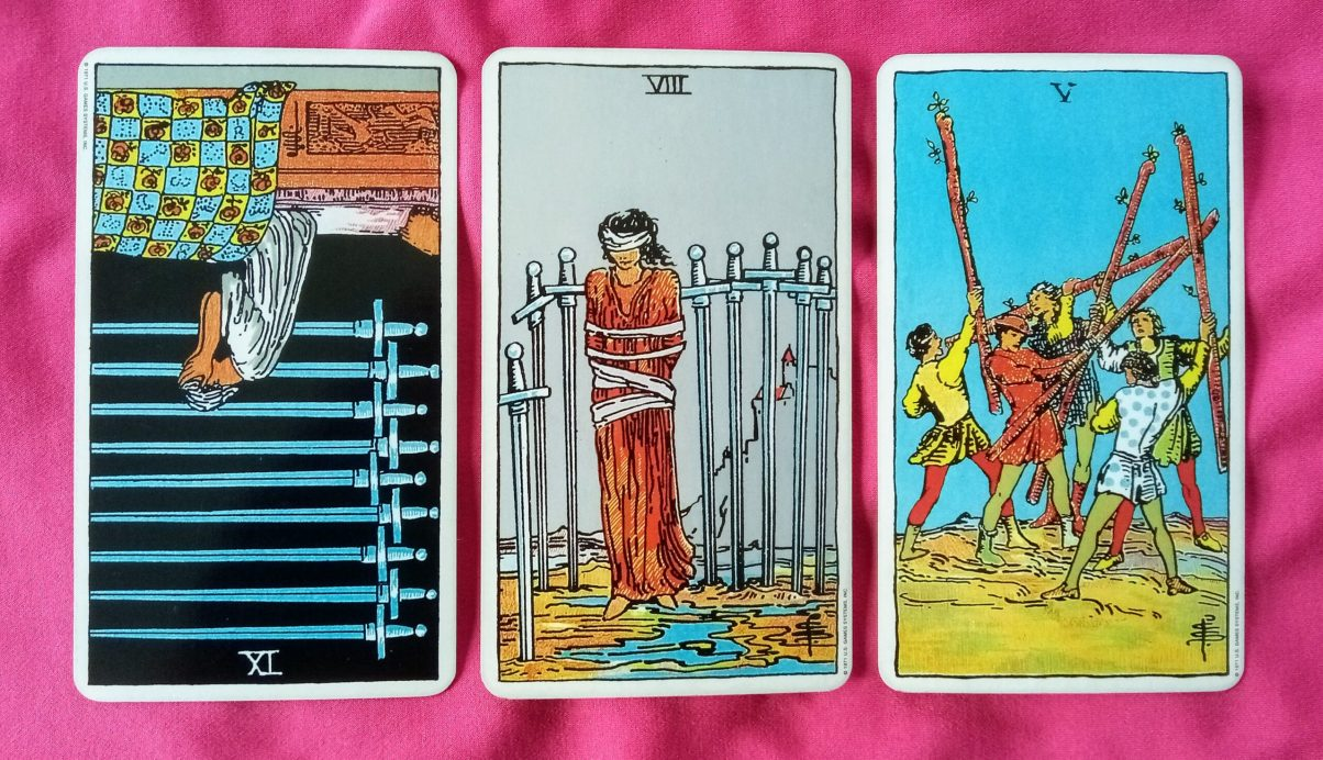 online soul purpose tarot reading cards: 9 of Swords reversed, 8 of Swords and 5 of Wands