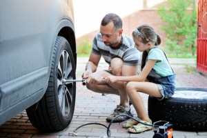 father-and-daughter-changing-tire