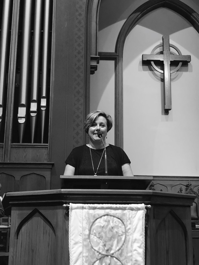Pastor Heather Hayes at the pulpit