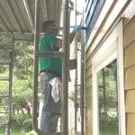 members painting habitat house