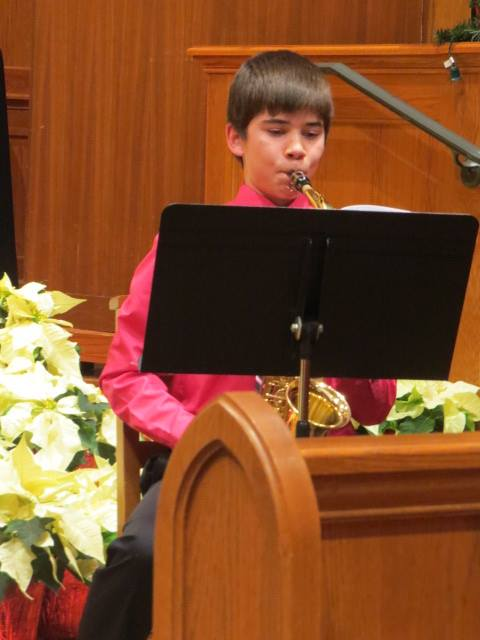 boy playing clarinet