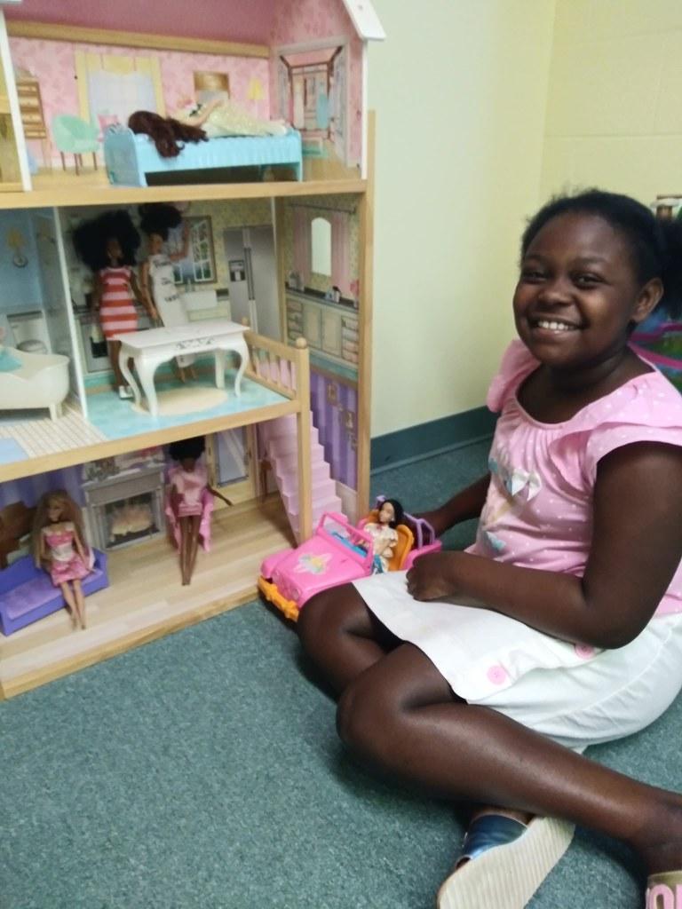 girl reading books in nursery