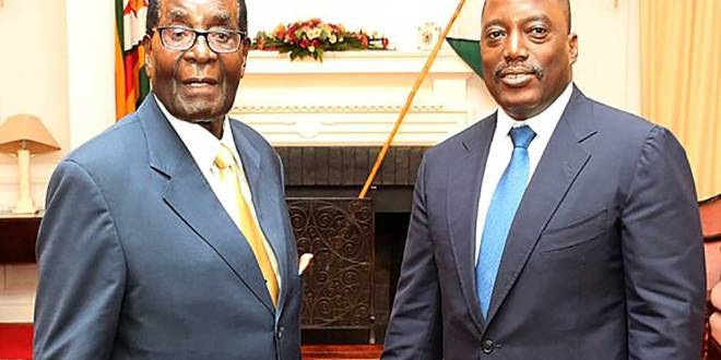 """Joseph KABILA"" et son homologue zimbabwéen, Robert MUGABE"