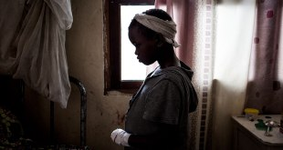 A little Congolese girl inside a house.
