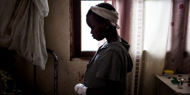 A little Congolese girl inside a house.