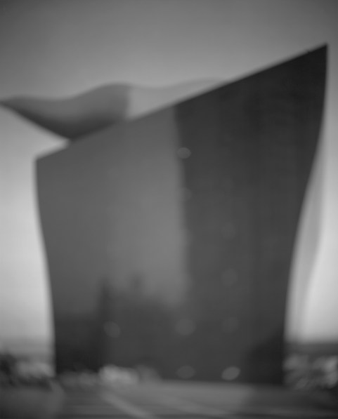 Black-and-white photograph of out of focus modern building with the appearance of a ship's hull
