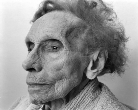 Black-and-white three-quarter photographic portrait of an elderly woman