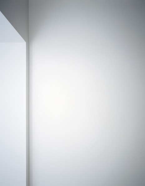 Photograph of a white wall next to a window cut out in varying shades of light gray
