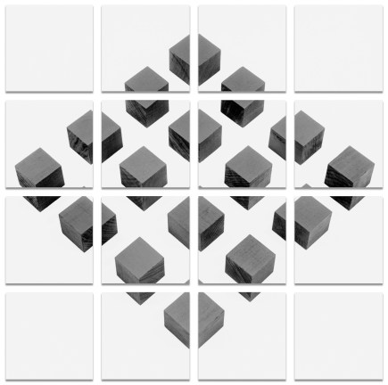 Square grid of 16 black-and-white photographs of cubes