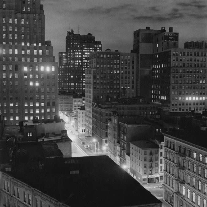 Black and white photograph of a cityscape at night