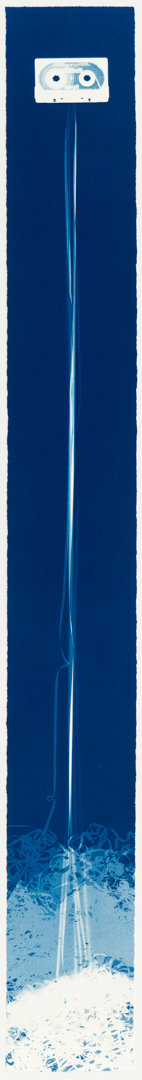 Vertical image of a white cassette at the top with its tape trailing to the bottom into a white blotch on a deep blue background