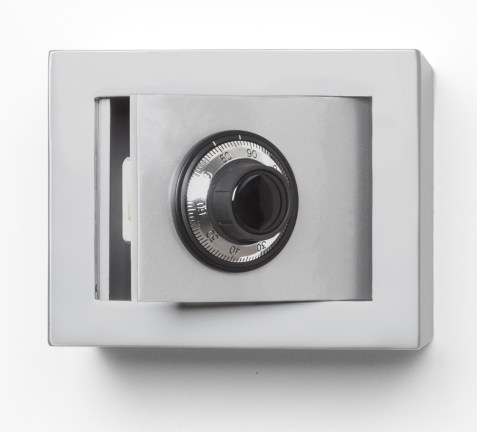 A wall mounted combination safe with the door open