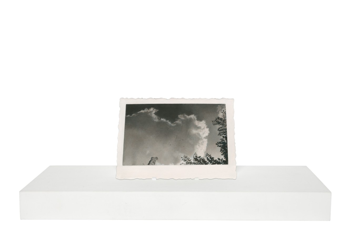 Painting of clouds and tips of tree branches on a wooden stand