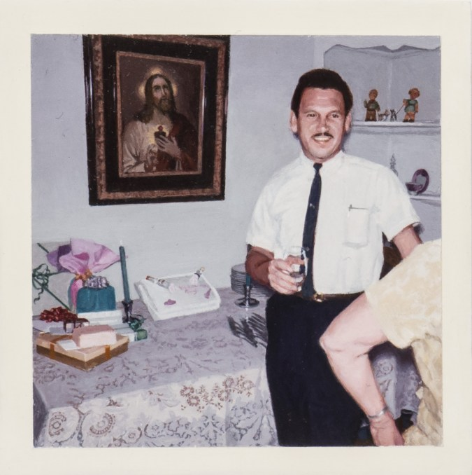 Painting of a man holding a glass standing next to a painting of Jesus and a table