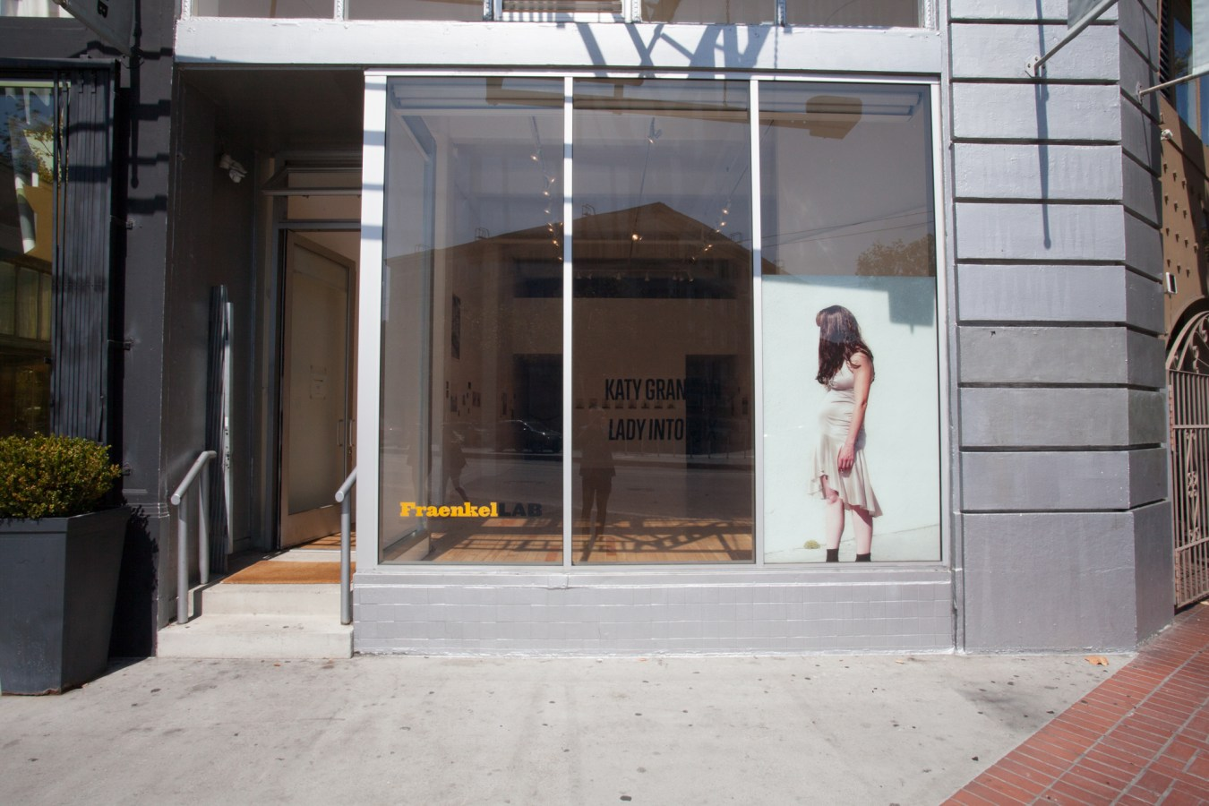 Installation photograph of a gallery storefront