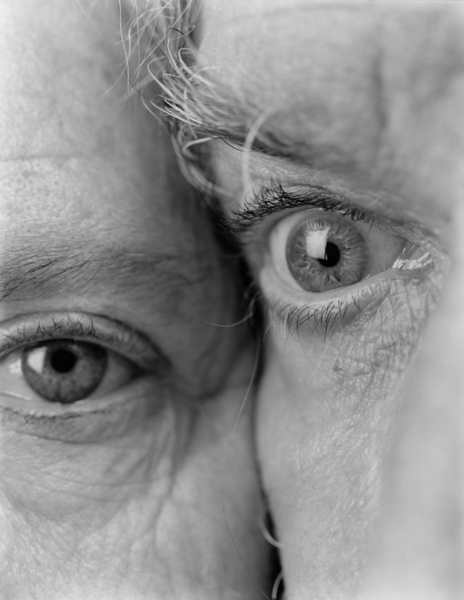 Black-and-white close-up photograph of the eyes of two people cheek-to-cheek