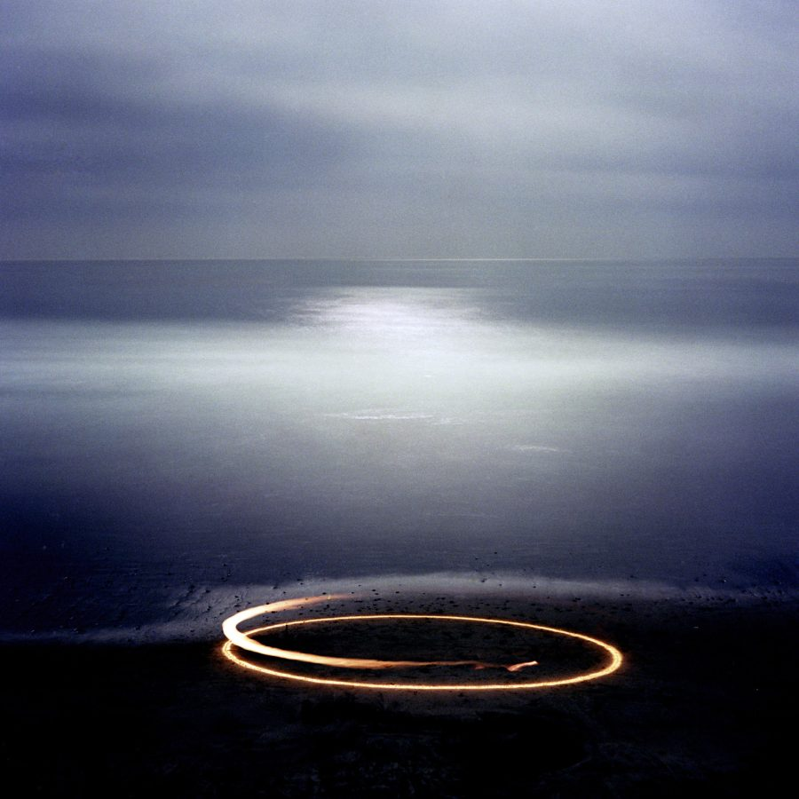 Color photograph of a blue expanse with a yellow circle in the foreground