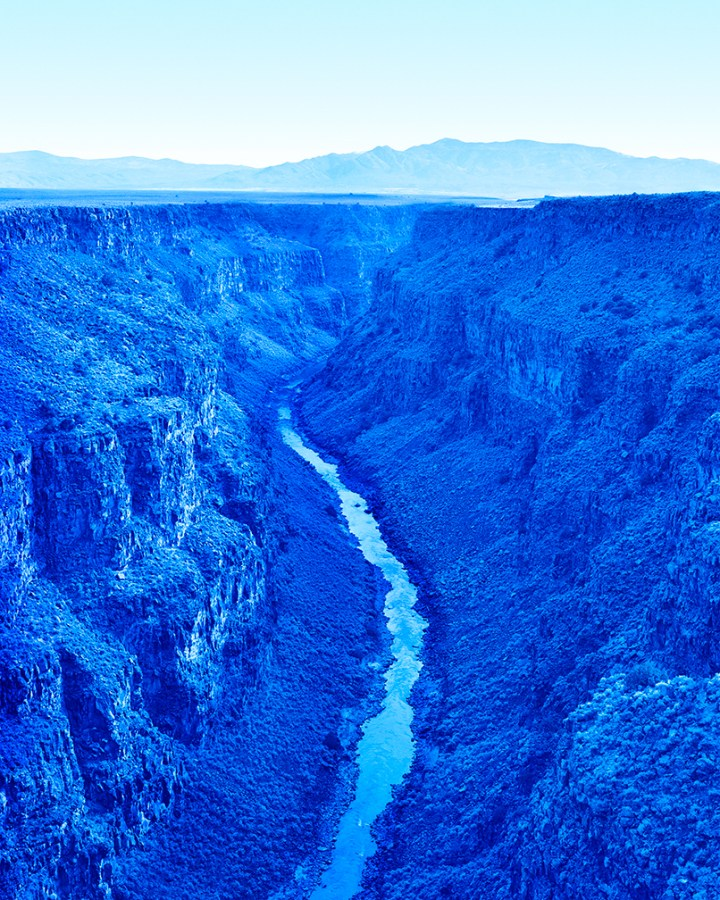 All-blue photograph of the Rio Grande valley, photographed from above.