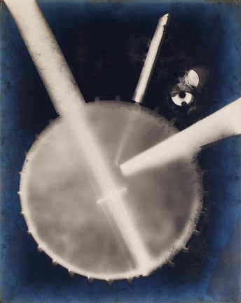 Abstract photogram of banjo instrument with blue background