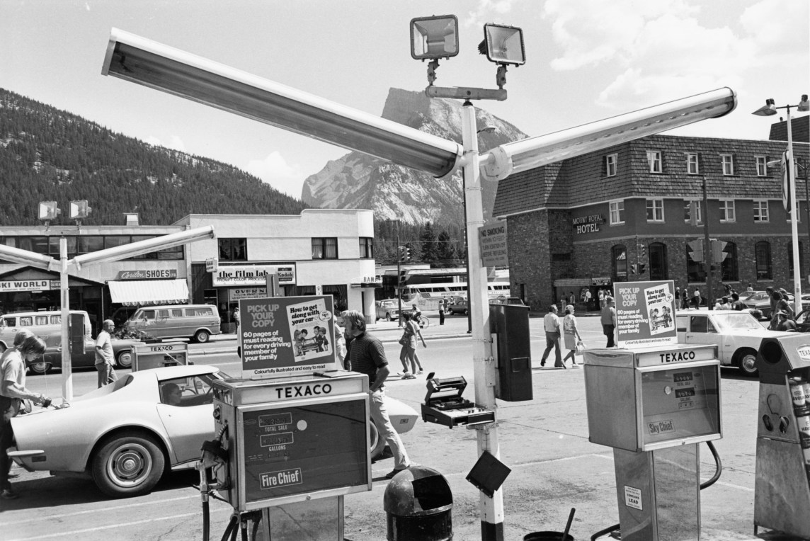 Black-and-white horizontal photograph of a gas station.